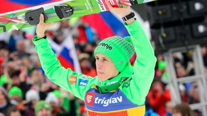 Peter Prevc of Slovenia celebrates after winning the FIS Ski Flying World Cup Individual event in Planica, Slovenia on March 17, 2016. / AFP PHOTO / Jure Makovec/AFP
